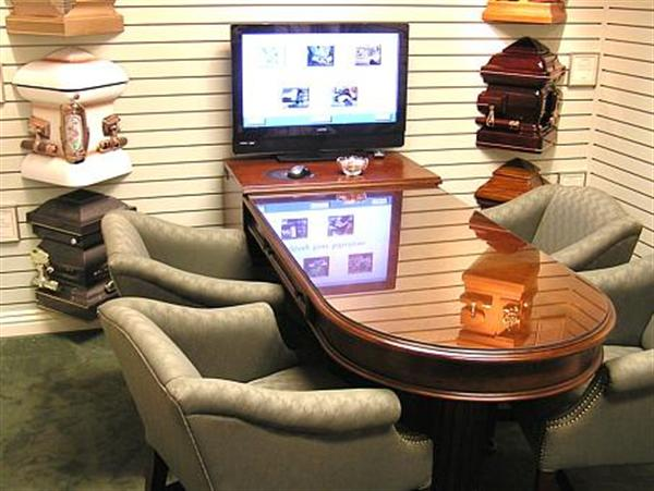 """Our arrangement offices also feature a demonstration of """"Memories By Design"""", a professionally edited video presentation of images of your loved one, combined with scenic video and music. The video which is recorded on DVD and presented to the family at the service, is just another example of what sets us apart from other funeral service providers."""