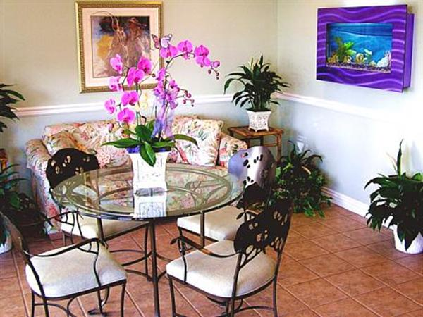 Fresh flowers, lush foliage, and beautiful artwork are present throughout, creating a relaxing atmosphere of comfort.