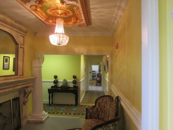 Hallway with beautiful lighting and eliqent paintings