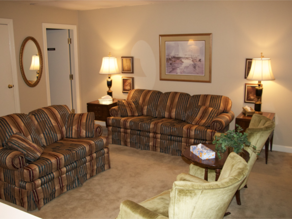 Family Lounge Next to the chapel is our comfortable lounge area where we provide water, coffee and private restroom. Families may gather here before and after funeral services.