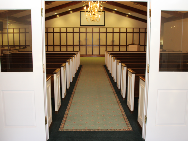 Entrance of Chapel We can seat 160 folks comfortably in the chapel and 50 in the family room without adding additional seating.
