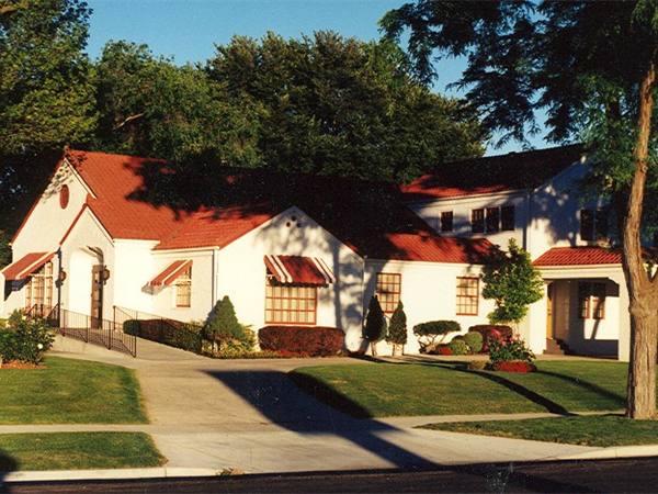 In 1911 C.V. Peckham, who owned and operated Peckham Furniture in Caldwell, Idaho, and Parma, Idaho, started Peckham Funeral Chapel. He started the funeral home with a goal to serve families in our communities in Canyon County and provide dignified and caring service to those families regardless of race, religion or financial means. In 1935 he took on a young associate, T. Wilbur Dakan. In 1937 the funeral home was moved out of the basement of the Peckham Furniture Store and the new facility was constructed