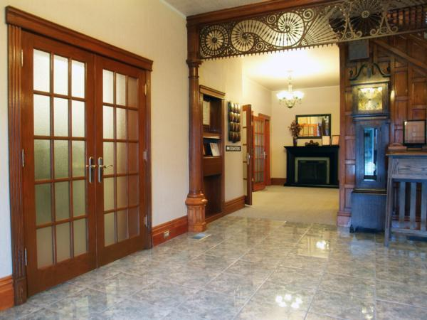 Beautiful front entrance with our 'one of a kind' woodwork and tile floor.