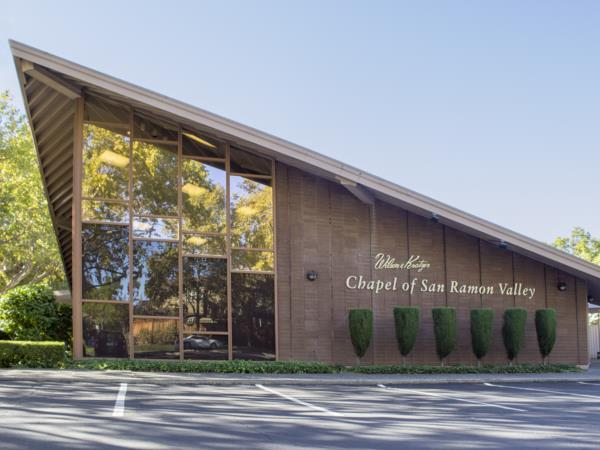 Wilson & Kratzer Chapel of San Ramon Valley is located in the former Danville Library, a landmark in the town of Danville.  The interior was completely renovated in 1998 but the outside remains as it always was. The decor is warm and inviting and seating in the chapel is composed of chairs in lieu of pews.  The facility is state of the art and has hosted many personalized ceremonies.  In addition to our chapel, we offer reception facilities for families to utilize when they have their service or visitation.