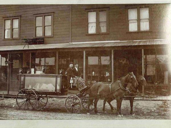 The horse-drawn hearse in uptown Whittier. Circa 1900.