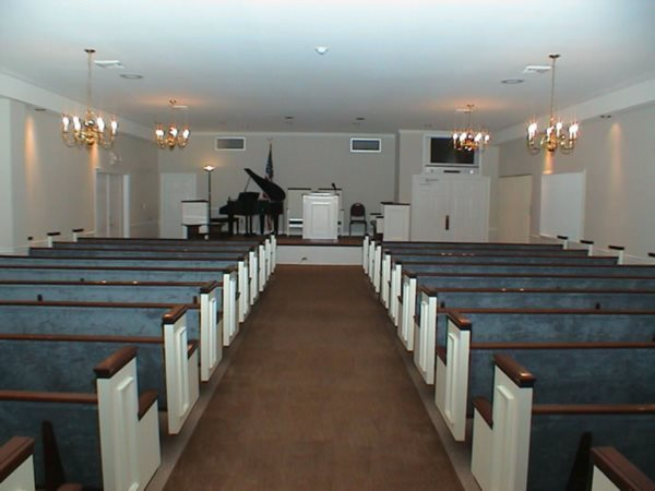 Horne Formal Chapel Seating for over 200, with rooms to the side with CC T.V. for seating for additional family and friends.