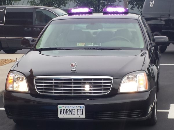 "Note the ""PURPLE LIGHTS""  atop the lead car  funeral homes may use purple or amber lights to lead and follow funerals and other funeral vehicles.  ALSO state laws says you shall use HAZARD LIGHTS ""4-way flashers"" for ALL vehicles in a funeral procession.  ""Hazard lights State Code 46.2-1040"""
