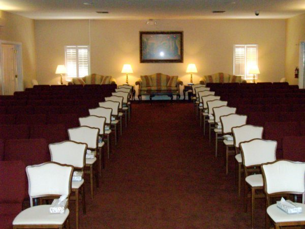 In the back of our large service chapel there is ample room for guests to visit during visitations and funeral services.