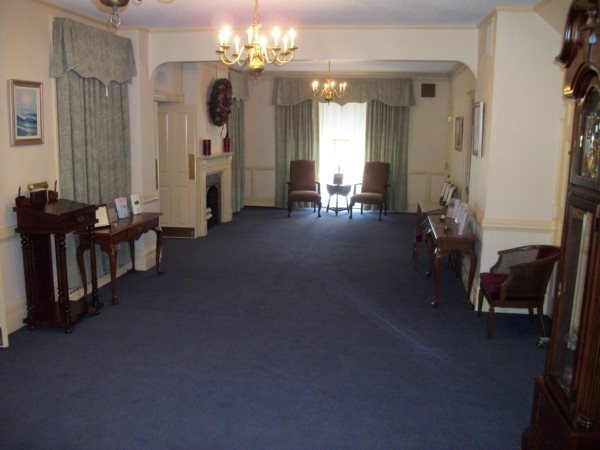 Our main foyer was previously the chapel, but is now a gathering area for family and friends, and is where photo collages and video tributes are viewed.