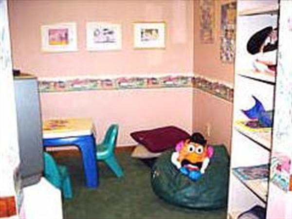 Children's Room: As more and more families are bringing children to visitations and services, we have found the addition of a Children's Room has been greatly received by all.  Little people now have an activity center to occupy themselves with Disney movies, games and coloring books.    Please take a moment to view some of our interior pictures.