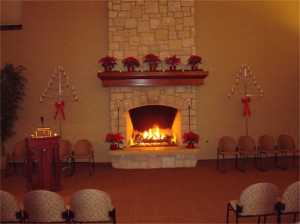The warm and inviting chapel fireplace allows for a peaceful, serene setting for any service a family desires.